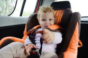 Cute baby enjoying a road trip in a baby car seat