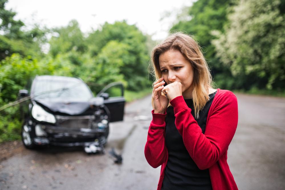 distressed woman calls for help after a car crash