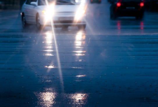 A car's headlights shining on a dark