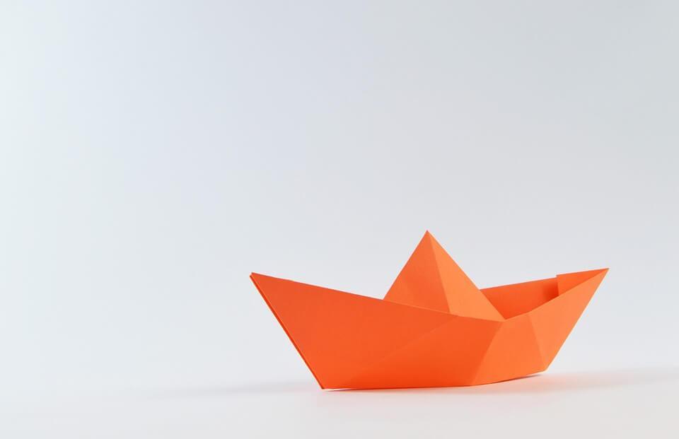 origami boat, paper boat in orange