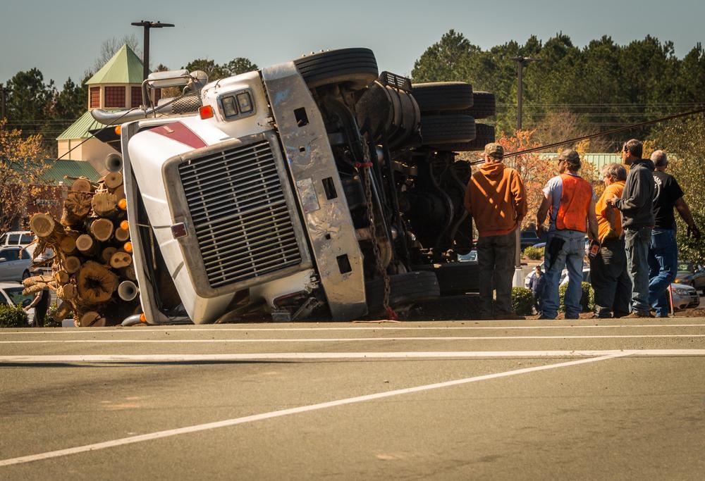 overturned logging truck