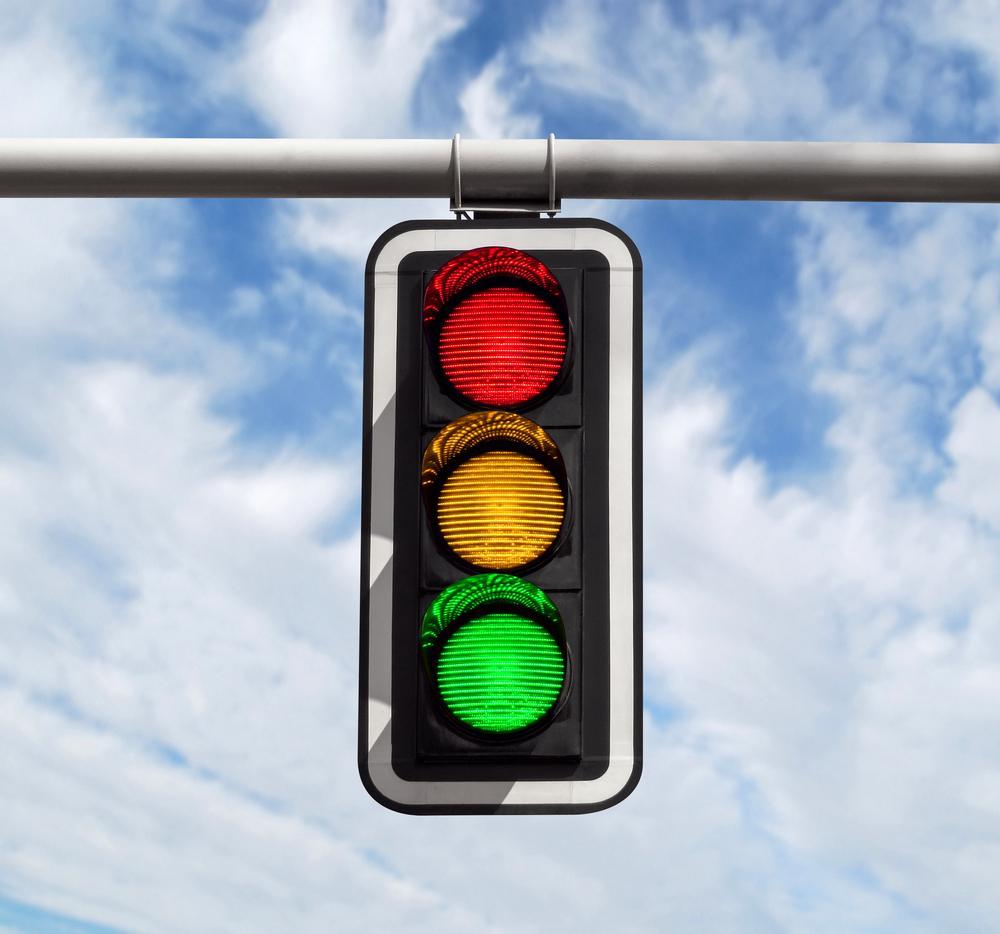 traffic light against blue sky