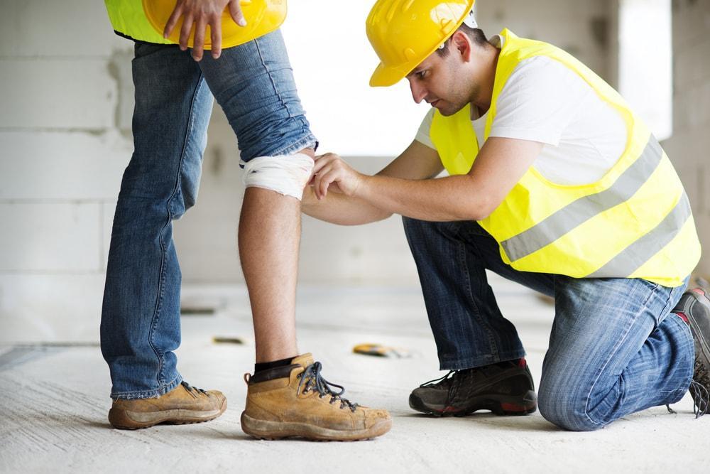 worker helping an injured worker walk