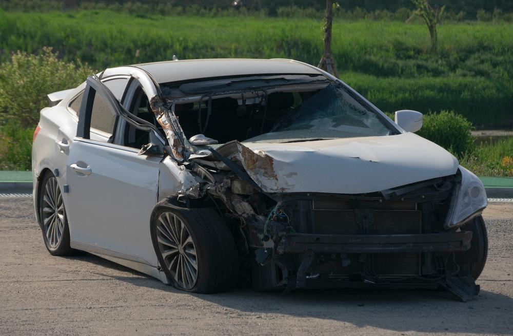 wrecked silver car