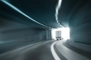 Truck going through a tunnel.
