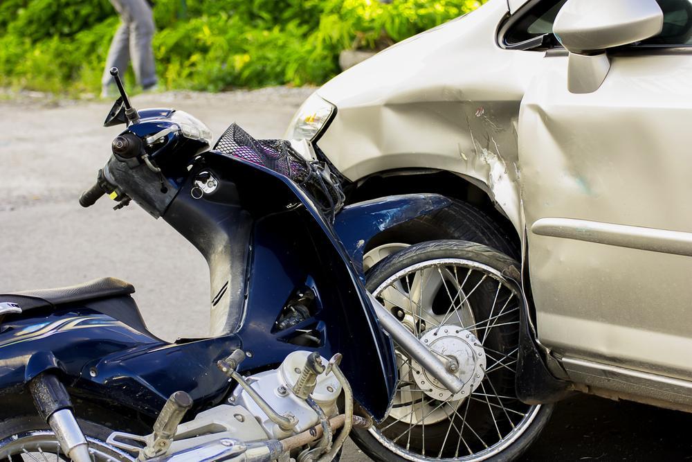 close-up of car and motorcycle crash