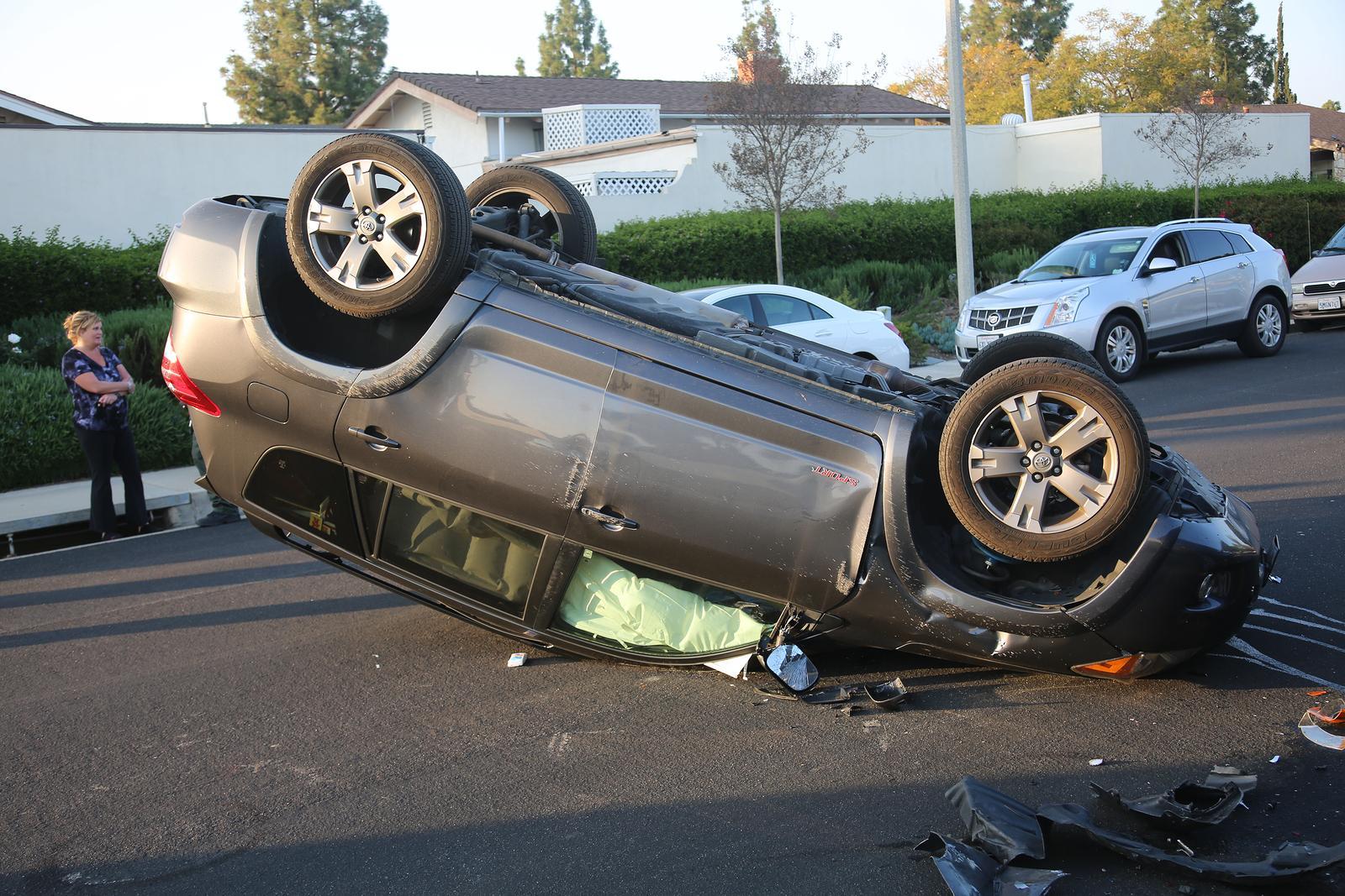 smashed-up rolled-over passenger vehicle