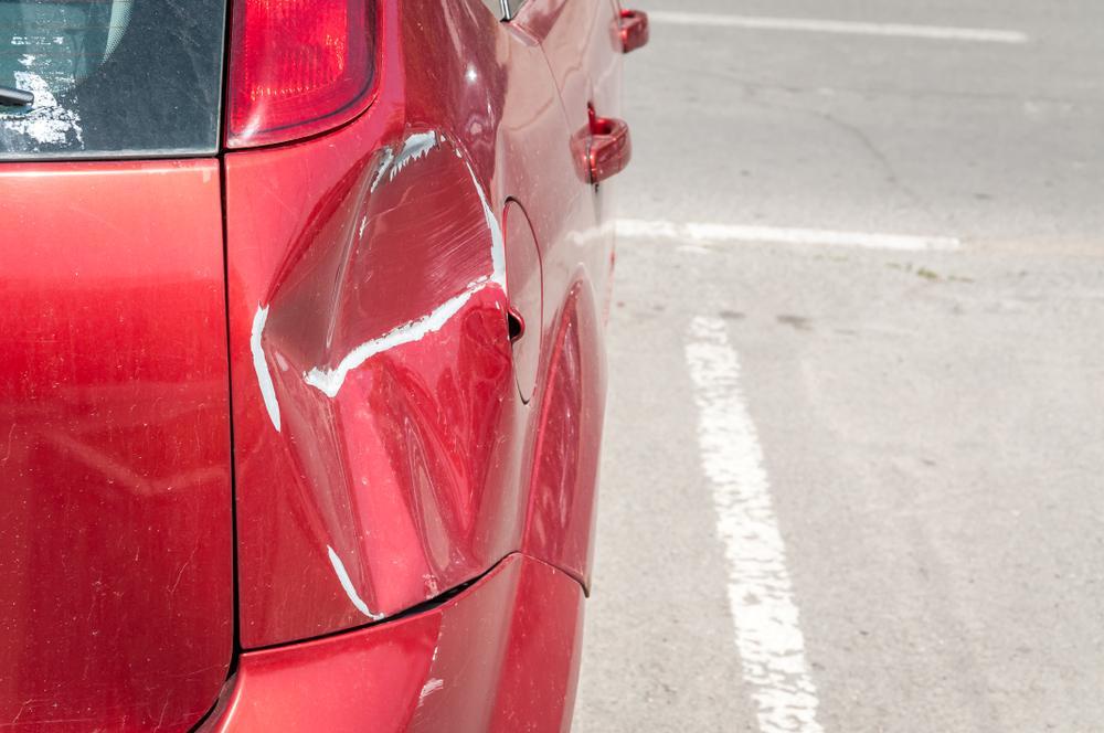 car damaged after fender bender in parking lot