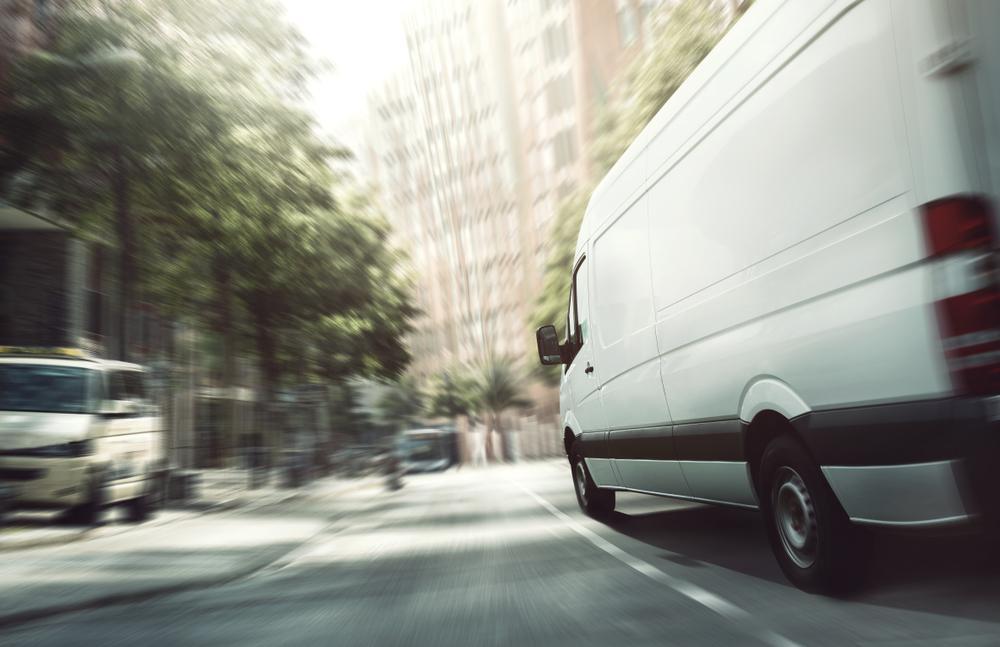 delivery van speeds along city street