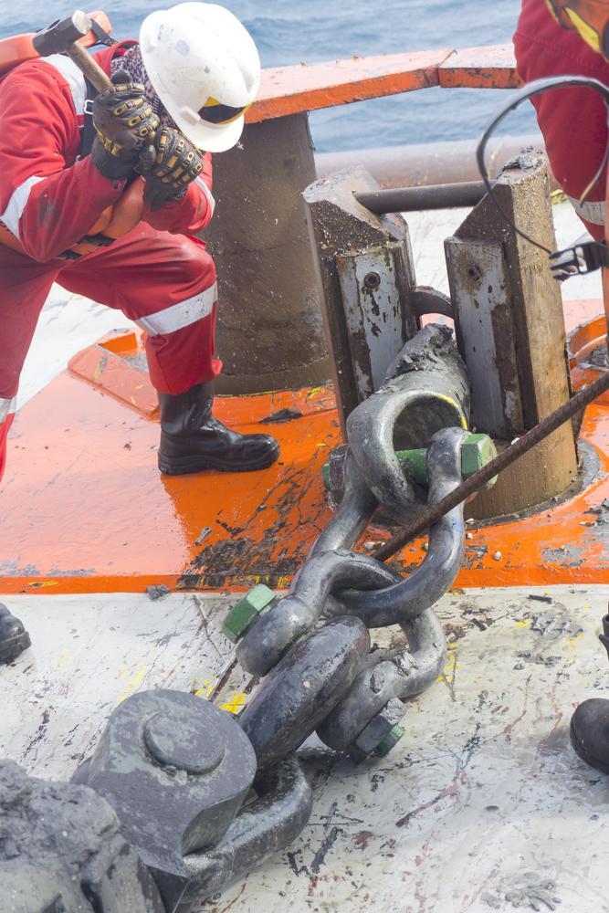 marine crew performs anchor handling setup