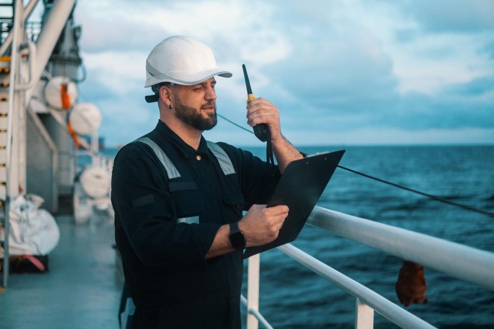 maritime worker using radio on ship