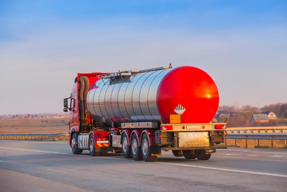 gasoline tanker driving down highway