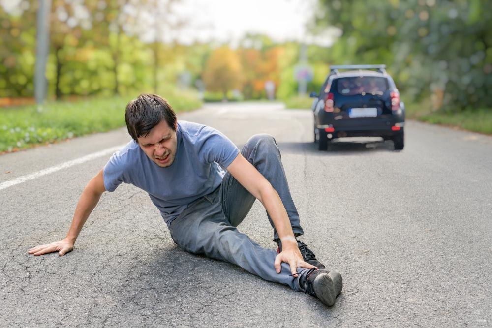 motorist runs over man and keeps driving